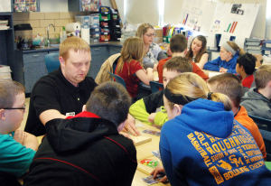 Staff Photo/Janice Barniak Matt Starr leads a hands on project Friday with STEM students.